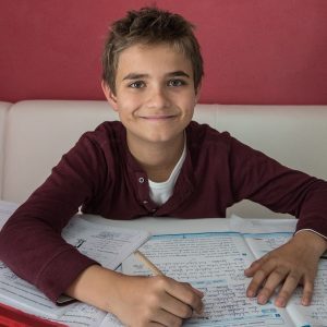 boy writing in a book